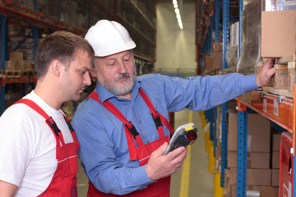 A view of a senior engineer training a newly hired employee.